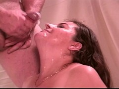 Large breasted MILF gets cum loads on her face and chest