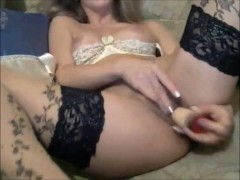 Breathtaking model in stockings toying pussy on cam