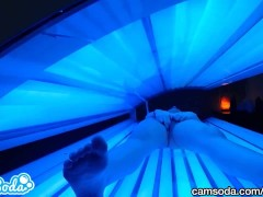 teen latina gets caught rubbing her clit while using a tanning bed