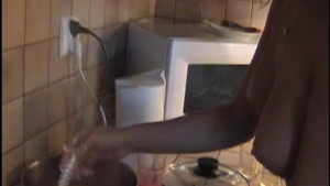 Naked Candi cooks and tastes