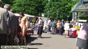 Naked cutie has fun in public streets