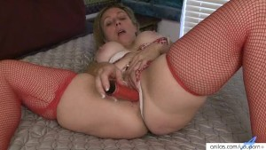 Busty curvy milf plays with sex toy collection.