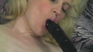 Blonde plays with her toys