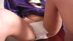 College cheerleader gets ready for the game