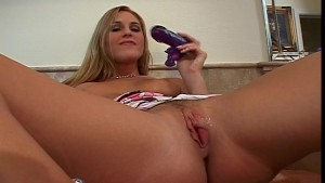 Lauren Phoenix relaxes with her purple monkey dildo