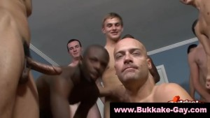 Bald gay covered in cum at bukkake party