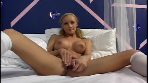 Busty blonde with pigtails solo scene