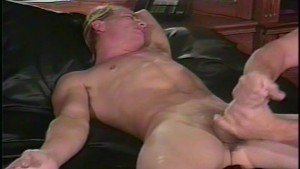 Athletic twink jerks his big dick off