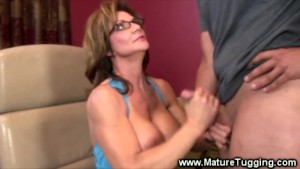Milf jerks young guys hard cock at her desk