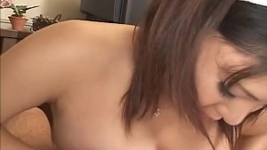 Naughty Japanese maid takes on a hard dick to titty fuck and suck