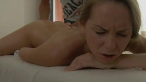 depraved brunette fucked on a massage table