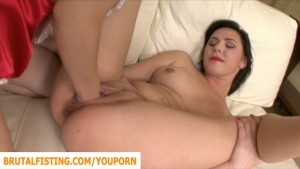 Babe is fisted in the pussy by her girlfriend