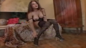 Busty milf in stockings a bra and sexy high heels