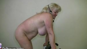 Chubby Grandma does strip in home gym