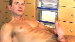 My gym trainer made a porn: watch him gets wanked his huge cock by a guy !