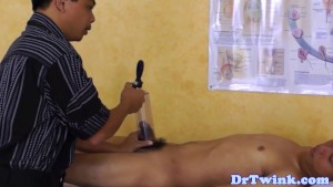 Asian doctor blows twink outdoor as first aid