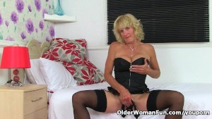 British milf Molly is showing off her fuckable body