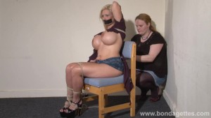 Lesbian bondage of Melanie Moon in tape gagged submission and kinky fetish tied to a stool by mistress Xinran