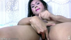 Naughty ladyboy strokes dick while fingering her tight ass