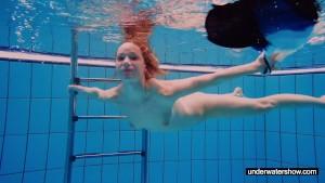 Teen girl Avenna is swimming in the pool