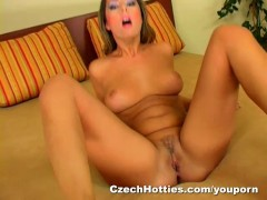 Brunette with great natural tits fucks her pussy