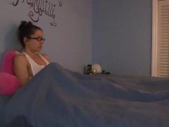 Shy nerdy girl masturbates under the sheets in pajamas
