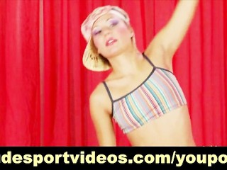 Sporty girl stripping and stretching
