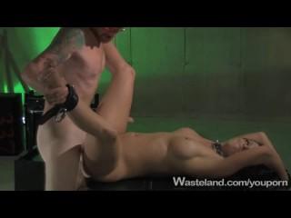 Brunette  submissive pupy suffers the fucking machine