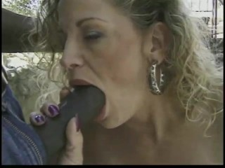 Blonde enjoys two black cocks