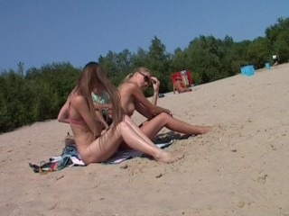 Nudist girls have fun with each other  edit