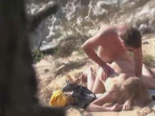 horny-couple-spied-on-the-beach