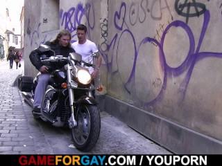 Boy seduces hunky biker...