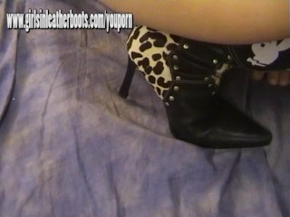 Redhead mistress digs leather boot in as she sucks and wanks studs big cock