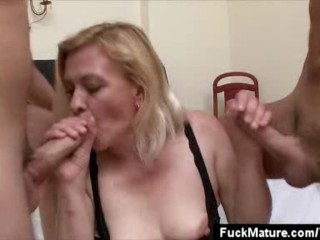 Blonde Mature Babe Sucks On Two Cocks