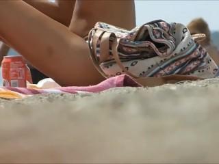 Topless beauty caught beach...